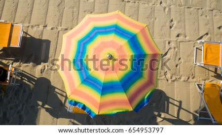Bird's eye view of colored umbrella in a beach in italy, Tuscany,Viareggio #654953797