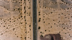 Bird's eye view of famous highway in America located on west wild sandy lands, aerial view of historic Landmark Route 66 with old cracked asphalt in desert environment