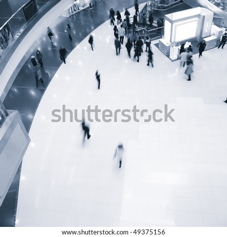 bird's view the hall,motion blur peoples in the mall. - stock photo