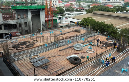 bird-view Construction site with concrete steels and workers