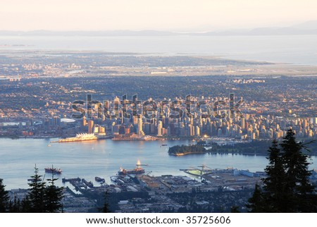 Bird view of vancouver cityscape from the grouse mountain at sunset moment, vancouver, british columbia, canada
