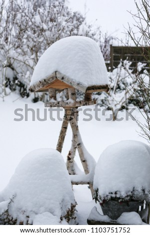 Birdhouse covered with snow #1103751752