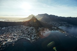 Birds eye view of city of cape town with beautiful beaches and mountain range on a sunny day. Aerial view of Cape Town city with Devil's Peak.
