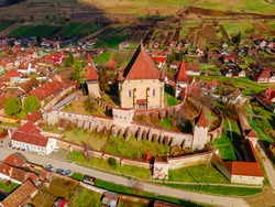 Birds eye view photography of a fortified church located in Romania, Biertan village. Drone shot of a medieval fortified church