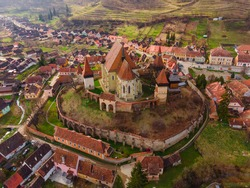 Birds eye view photography of a fortified church located in Romania, Biertan village. Drone shot of a medieval fortified church.