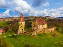 Birds eye view photography of a fortified church ruin located in Sibiu, Romania. Drone shot of a medieval fortified church
