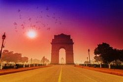 birds fly over india gate with sun shining, new delhi, india