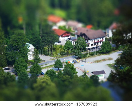 Birdseye view of a cross road with buildings - stock photo