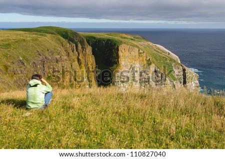 Birdwatcher on Cape St Mary's in Newfoundland