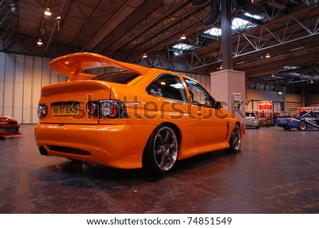 BIRMINGHAM, ENGLAND, JULY 5: Orange Ford Escort Cosworth on Display at the Annual StreetLife Car Show on July 5, 2008 in Birmingham, England, UK.  Birmingham NEC is host to the show