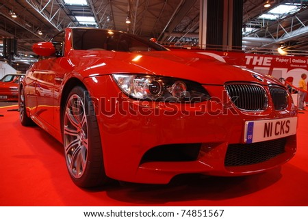 BIRMINGHAM, ENGLAND, JULY 5: Red BMW M5 on Display at the Annual StreetLife Car Show on July 5, 2008 in Birmingham, England, UK.  Birmingham NEC is host to the show