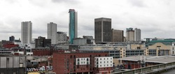 Birmingham skyline panorama with modern office buildings seen from Digbeth. West Midlands, England. Rainy day.