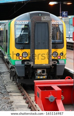 BIRMINGHAM, UK - APRIL 19: London Midland train on April 19, 2013 in Birmingham, UK. It is part of Go-Ahead group, international transport company with 23,563 employees (2013).