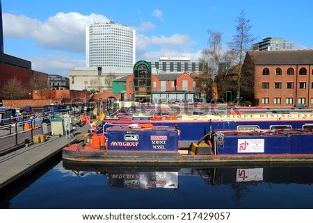 BIRMINGHAM, UK - APRIL 19, 2013: Narrowboats moored at Gas Street Basin in Birmingham, UK. Birmingham is the 2nd most populous British city. It has rich waterway and boat culture.