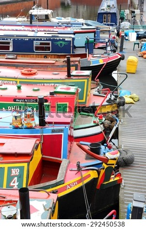 BIRMINGHAM, UK - APRIL 24, 2013: Narrowboats moored at Gas Street Basin in Birmingham, UK. Birmingham is the 2nd most populous British city. It has rich waterway and boat culture.