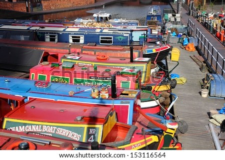 BIRMINGHAM, UK - APRIL 19: Narrowboats moored at Gas Street Basin on April 19, 2013 in Birmingham, UK. Birmingham is the 2nd most populous British city. It has rich waterway and boat culture.