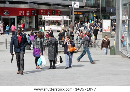 BIRMINGHAM, UK - APRIL 19: People shop downtown on April 19, 2013 in Birmingham, UK. Birmingham is the most populous British city outside London with 1.07 million residents.