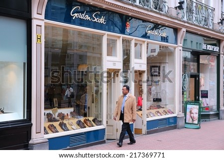 BIRMINGHAM, UK - APRIL 19, 2013: Person walks by Gordon Scott shoe store in Birmingham, UK. Gordon Scott is a brand of Jones Bootmaker (100 locations in the UK), company founded in 1857.