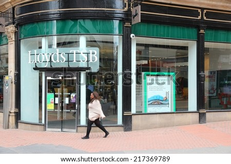 BIRMINGHAM, UK - APRIL 19, 2013: Person walks by Lloyds TSB bank in Birmingham, UK. Lloyds Banking Group had GBP 23.5 billion of revenue in 2011