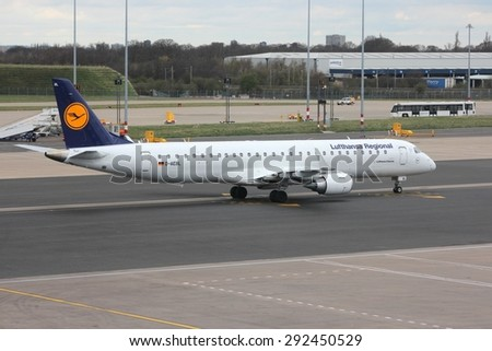 BIRMINGHAM, UK - APRIL 24, 2013: Pilots taxi Lufthansa Embraer ERJ-195 at Birmingham Airport, UK. Lufthansa carried 103 million passengers in 2012.