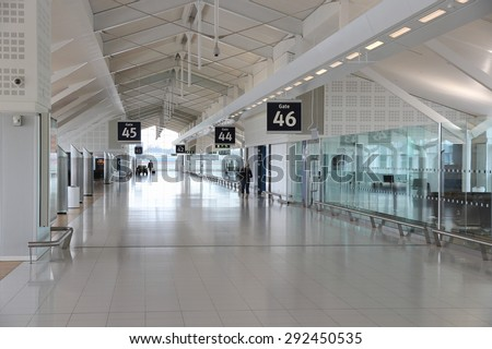 BIRMINGHAM, UK - APRIL 24, 2013: Travelers wait at Birmingham International Airport, UK. With 8.9 million travelers served it was the 7th busiest UK airport in 2012.
