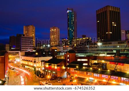 Birmingham UK cityscape at night british metropolitan skyline picture view to the rush streets traffic trails high resolution european union nightscape United Kingdom 6/2017  #674526352