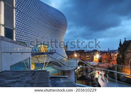 BIRMINGHAM, UK - JANUARY 30: Night scene in downtown Birmingham, UK on January 30, 2013 with the Selfridges Department Store overlooking the city\' skyline.