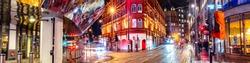 Birmingham, UK. Night life in the center of Birmingham, UK. Dark black sky with illuminated buildings, shops and stores.
