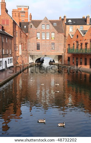 Birmingham water canal network - famous Gas Street Basin with wild geese. West Midlands, England.