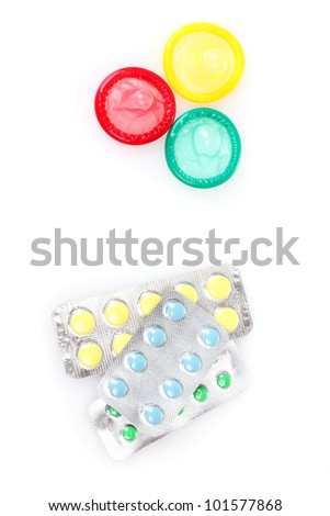 birth condoms and control pills isolated on white