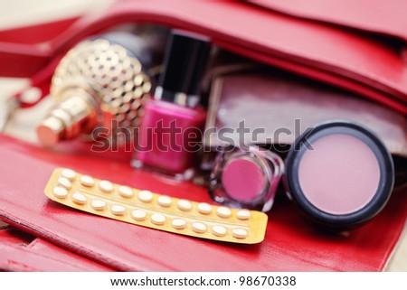 birth control pill in handbag - healthcare and medicine