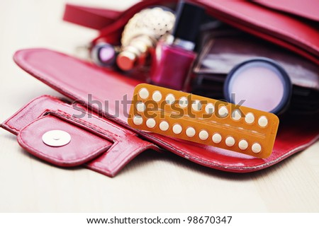 birth control pill in handbag - healthcare and medicine