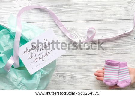 birth of child - baby shower concept on wooden background #560254975