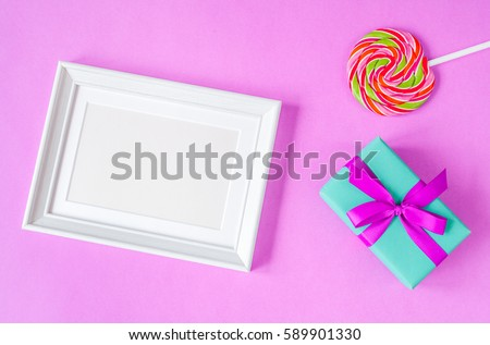 birth of child - blank picture frame on purple background