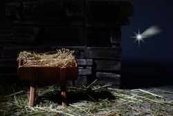 Birth of Jesus. Christmas nativity scene. Manager and star.