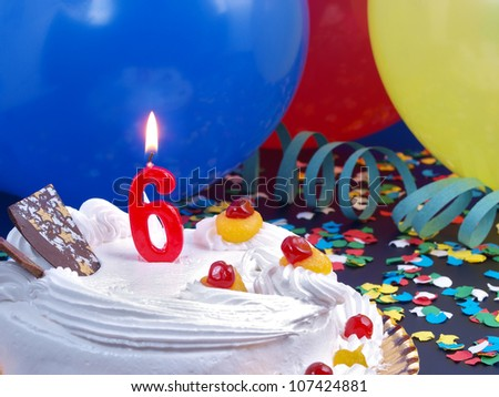 Birthday-anniversary cake with red candle showing Nr. 6