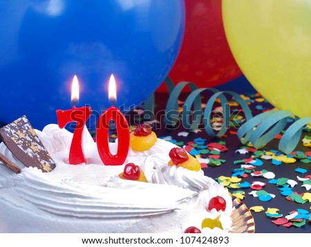 Birthday-anniversary cake with red candle showing Nr. 70