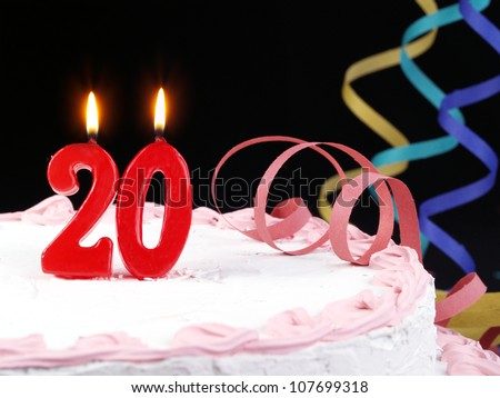 Birthday-anniversary cake with red candle showing Nr. 20