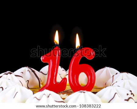 Birthday-anniversary cake with red candles showing Nr. 16