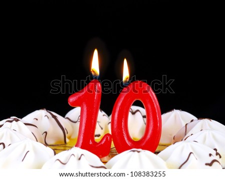 Birthday-anniversary cake with red candles showing Nr. 10