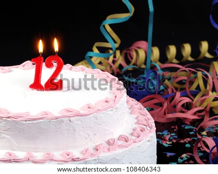 Birthday-anniversary cake with red candles showing Nr. 12