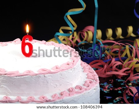 Birthday-anniversary cake with red candles showing Nr. 6