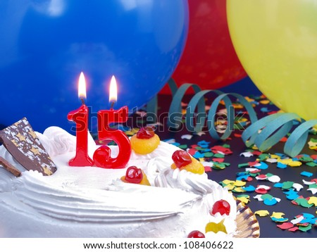 Birthday-anniversary cake with red candles showing Nr. 15