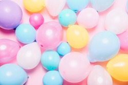 Birthday background with colorful balloons, top view