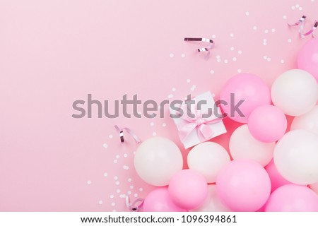 Birthday background with gift or present box, balloons and confetti on pink pastel table from above. Flat lay style. #1096394861