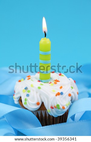 Birthday cake on blue background - stock photo
