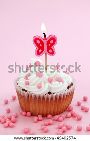 Birthday cake on pink background