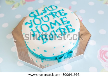 Birthday Cake with blue dots and mastic text \