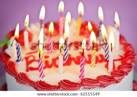 Birthday cake with burning candles and icing