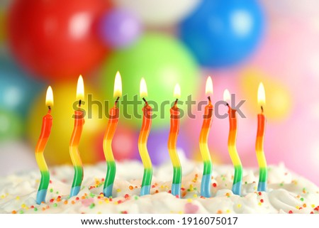 Birthday cake with burning candles on blurred background, closeup Foto stock ©